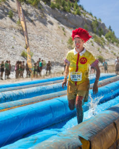BOISE, IDAHO/USA - AUGUST 10, 2013: Runner 38174 dressed as Ronald Mcdonald the Mcdonalds mascot at the The Dirty Dash - Shot Your show