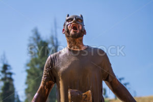 BOISE, IDAHO/USA - AUGUST 10, 2013: Runner 8272 sceams like a superhero at the The Dirty Dash - Shot Your show