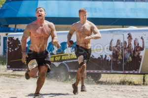 BOISE, IDAHO/USA - AUGUST 10, 2013: Two men run fast to finish the race at the The Dirty Dash - Shot Your show