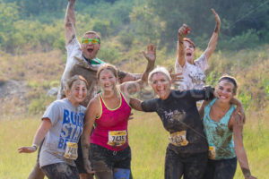 BOISE, IDAHO/USA - AUGUST 10: Group of people pose during the race at the The Dirty Dash in Boise, Idaho on August 10, 2013  - Shot Your show