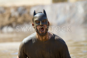 BOISE, IDAHO/USA - AUGUST 10: Runner 8272 screams at the camera during the The Dirty Dash in Boise, Idaho on August 10, 2013  - Shot Your show