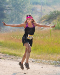BOISE, IDAHO/USA - AUGUST 10: Runner 9245 strikes a running pose during her race at the The Dirty Dash in Boise, Idaho on August 10, 2013  - Shot Your show