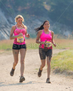 BOISE, IDAHO/USA - AUGUST 10: Runners 7881 and 7761 run down the dirt track at the The Dirty Dash in Boise, Idaho on August 10, 2013  - Shot Your show