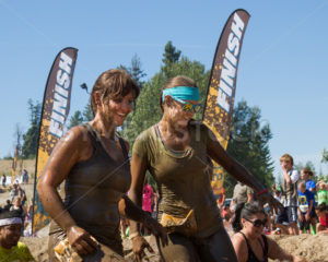BOISE, IDAHO/USA - AUGUST 10: Runners smile as they complete the 10k Dirty Dash in Boise, Idaho on August 10, 2013 - Shot Your show