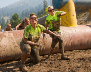 BOISE, IDAHO/USA - AUGUST 10: Two women as they finish one of the obstacles at the The Dirty Dash in Boise, Idaho on August 10, 2013 - Shot Your show