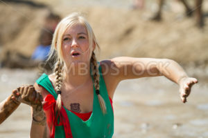 BOISE, IDAHO/USA - AUGUST 10: Unidentified woman gets a helping hand at the The Dirty Dash in Boise, Idaho on August 10, 2013  - Shot Your show