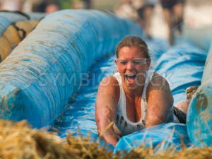 BOISE, IDAHO/USA - AUGUST 10: Unidentified woman smiles down the slide at the The Dirty Dash in Boise, Idaho on August 10, 2013  - Shot Your show