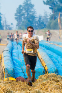 BOISE, IDAHO/USA - AUGUST 10:Unidentified person runs off the hay at the The Dirty Dash in Boise, Idaho on August 10, 2013  - Shot Your show