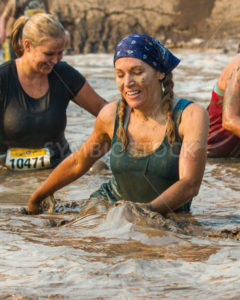 BOISE, IDAHO/USA - AUGUST 10:Unidentified woman makes a splash through the mud pit at the The Dirty Dash in Boise, Idaho on August 10, 2013  - Shot Your show