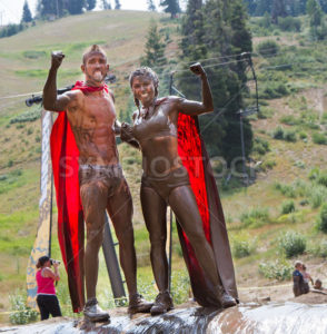 BOISE, IDAHO/USA - AUGUST 11, 2013: Two people dressed as superheros celebrate during the dirty dash - Shot Your show