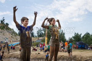 BOISE, IDAHO/USA - AUGUST 11, 2013: Two people make a strong man pose at the end of the dirty dash - Shot Your show