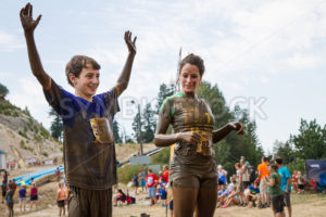 BOISE, IDAHO/USA - AUGUST 11, 2013: Two unidentified people celebrating at the finish line at the dirty dash - Shot Your show