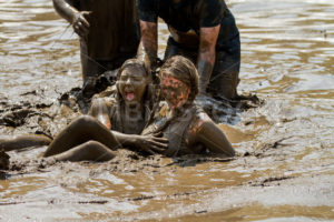 BOISE, IDAHO/USA - AUGUST 11, 2013: Two unidentified woman after falling into the mud at the dirty dash - Shot Your show