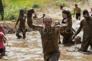 BOISE, IDAHO/USA - AUGUST 11, 2013: Unidentified man shows in strength at the dirty dash - Shot Your show