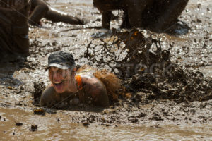BOISE, IDAHO/USA - AUGUST 11, 2013: Unidentified person makes a mess in the mud pit after falling at the dirty dash - Shot Your show