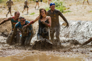 BOISE, IDAHO/USA - AUGUST 11, 2013:  Unidentified woman makes a final dash to the finish at the dirty dash - Shot Your show