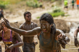 BOISE, IDAHO/USA - AUGUST 11, 2013: Unidentified woman struggles to see at the dirty dash - Shot Your show