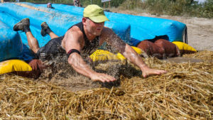 BOISE, IDAHO/USA - AUGUST 11: Unidentified man speeds into the hay at the The Dirty Dash in Boise, Idaho on August 11, 2013  - Shot Your show