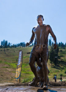 BOISE, IDAHO/USA - AUGUST 11: Unidentified runner climbs up and over the last hill at the The Dirty Dash in Boise, Idaho on August 11, 2013  - Shot Your show