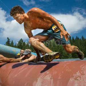 BOISE, IDAHO/USA - AUGUST 11: Unidentified runner jumps over an obstacle at the The Dirty Dash in Boise, Idaho on August 11, 2013  - Shot Your show