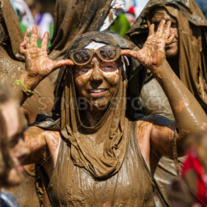 BOISE, IDAHO/USA - AUGUST 25 - Unidentified woman takes off her goggles after running in the Dirty Dash - Shot Your show