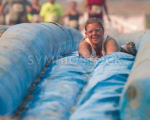 BOISE, IDAHO/USA - AUGUST: Unidentified woman slides face first down the slide at the The Dirty Dash in Boise, Idaho on August , 2013  - Shot Your show