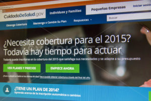 BOISE, IDAHO/USA - DECEMBER 24, 2014: Healthcare.gov in spanish to help our hispanic citizens get coverage - Shot Your show