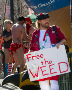 BOISE, IDAHO/USA FEBRUARY 13, 2016: During the Cupid Underwear Run for neurofibromatosis a man shows his pro marijuana sign in Boise, Idaho - Shot Your show