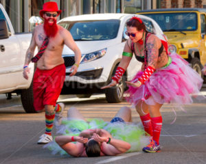 BOISE, IDAHO/USA FEBRUARY 13, 2016 Man fell over and is being helped up by someone else at the Cupids Underwear Run in Boise, Idaho - Shot Your show