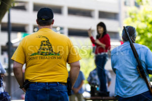 BOISE, IDAHO/USA - JULY 1, 2016: Man in a don't tread on me tshirt carries his sidearm to support the permitless carry law going into effect on July 1st, 2016 - Shot Your show