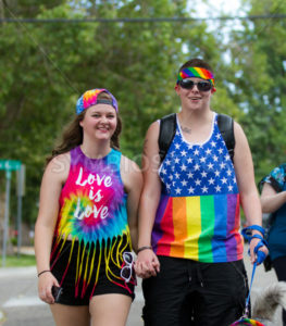BOISE, IDAHO/USA - JUNE 20, 2016: People holding hands during the boise Pridefest Parade - Shot Your show