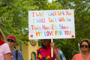 BOISE, IDAHO/USA - JUNE 20, 2016: Person walking with a sign trying to support the LGBT community during Boise Pridefest - Shot Your show