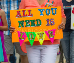 BOISE, IDAHO/USA - JUNE 20, 2016: Sign reading all you need is love during Boise Pridefest - Shot Your show