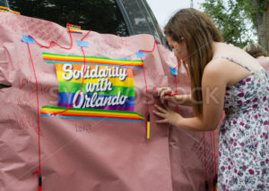 BOISE, IDAHO/USA - JUNE 20, 2016: Woman signing a banner in honor of those of the Orlando Shooting - Shot Your show