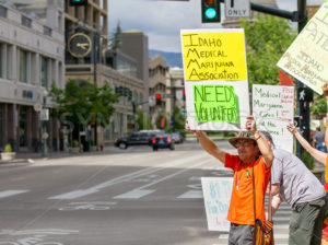 BOISE, IDAHO/USA - MAY 7, 2016: Man letting people know that the Idaho Medical Marijuana Association needs volunteers during the Global Marijuana March in Boise, Idaho - Shot Your show