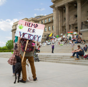 BOISE, IDAHO/USA - MAY 7, 2016: Man listening to the public speakers during the Boise, Idaho march for making pot legal - Shot Your show
