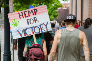BOISE, IDAHO/USA - MAY 7, 2016: Woman walking to the Boise Capital during the Global Marijuana March in Boise - Shot Your show