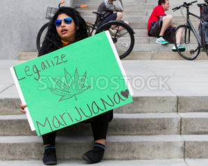 BOISE, IDAHO/USA - MAY 7, 2016: woman in proud support of making marijauan legal at the Global Marijuana march in Boise, Idaho - Shot Your show