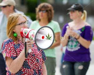 BOISE, IDAHO/USA - MAY 7, 2016: woman speaking about pot at the Boise Global Marijauna March - Shot Your show