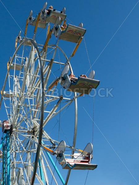 BOISE/IDAHO – AUGUST 19: Fair goers on the merry go round at the Idaho Fair in Boise, Idaho on August 19, 2012. - Shot Your show