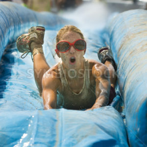 BOISE/IDAHO – AUGUST 25: Head on view of a runner taking on the slide during The Dirty Dash in Boise, Idaho on August 25, 2012 - Shot Your show