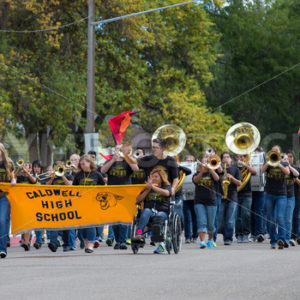 CALDWELL, IDAHO/USA – SEPTEMBER 27: A Group of students start the parade playing music and carry a banner at the Caldwell High School Homecoming parade on September 27, 2013 - Shot Your show
