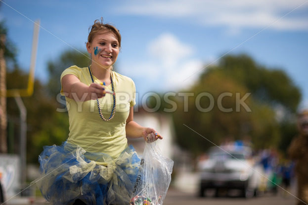 CALDWELL, IDAHO/USA – SEPTEMBER 27: Student passing out candy to the crowd at the Caldwell High School Homecoming parade on September 27, 2013 - Shot Your show