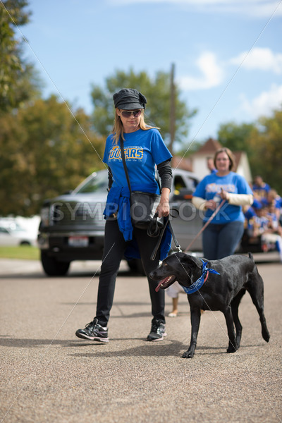 CALDWELL, IDAHO/USA – SEPTEMBER 27: Unidentified woman walks her dog through the Caldwell High School Homecoming parade on September 27, 2013 - Shot Your show