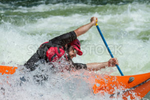 CASCADE, IDAHO/USA - JUNE 21, 2014: Boater stuck in the wave and trying to paddle out during the Payette River Games - Shot Your show