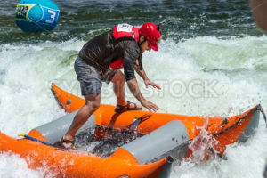 CASCADE, IDAHO/USA - JUNE 21, 2014: Boater stuck standing up to work his way out of a wave - Shot Your show
