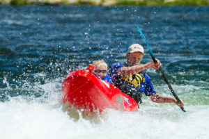 CASCADE, IDAHO/USA - JUNE 21, 2014: Father and son doing some canoe time during the Payette River Games - Shot Your show