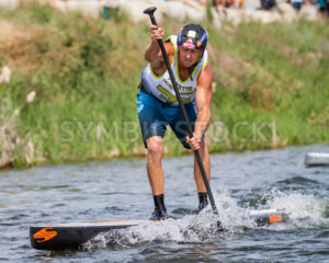 CASCADE, IDAHO/USA - JUNE 21, 2014: Focused on the finish line a SUP is near the end at the Payette River Games - Shot Your show