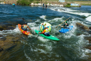 CASCADE, IDAHO/USA - JUNE 21, 2014: Group of kayakers are working their way aroudn a bouy - Shot Your show