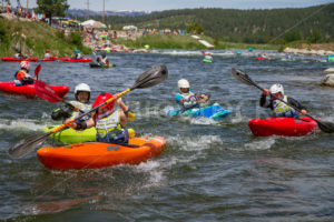 CASCADE, IDAHO/USA - JUNE 21, 2014: Group of racers trying to make it to the finish during the 8 ball race at the Payette River Games - Shot Your show
